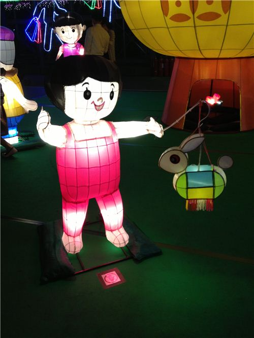 A lantern girl holding a lantern for the Mid-Autumn festival