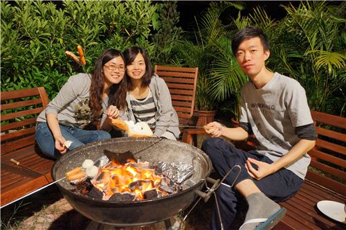 Maggie, Karen and Ho barbecuing their food