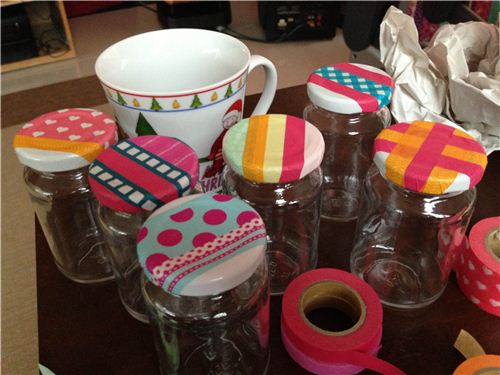 Just stick colourful Masking Tapes on the lids of the jars