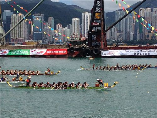 Teams from all over the world raced each other in dragon boats in the harbour