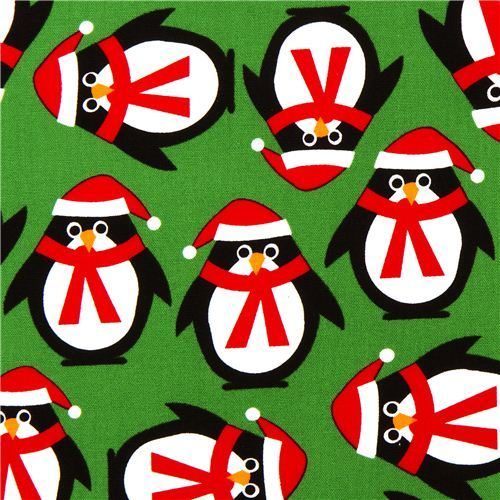 green Christmas fabric with penguins by Robert Kaufman