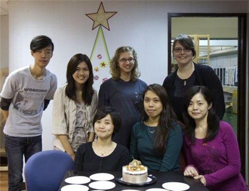 Our team with the birthday cake in front of our Washi Christmas tree