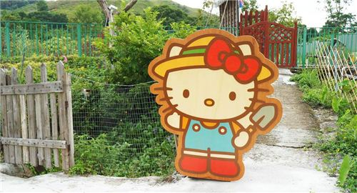 Hello Kitty decoration with garden tool