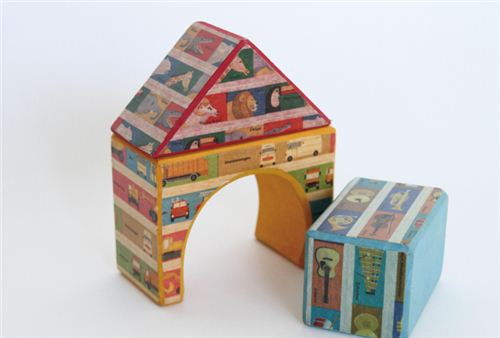 Decorate some wooden toy blocks with masking tape