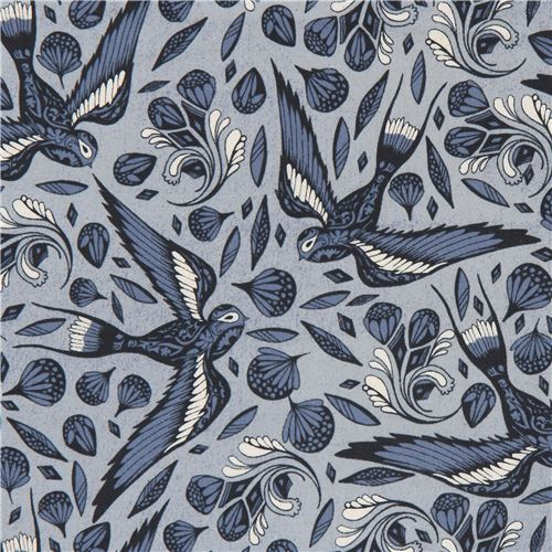 blue fabric with bird animal flower fabric by Cotton and Steel