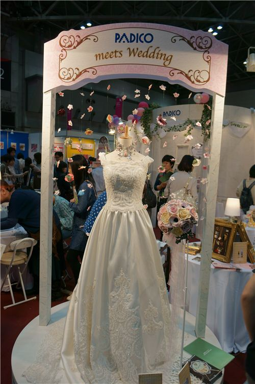 The wedding dress is not made from clay, but all the decoration around it