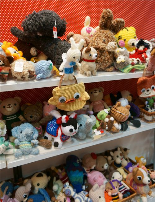 Shelves full of cute crochet plushies and bags