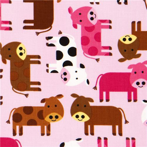 pale pink fabric with dotted cows by Robert Kaufman USA