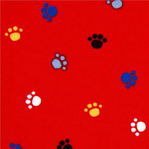 red animal paws fabric by Robert Kaufman