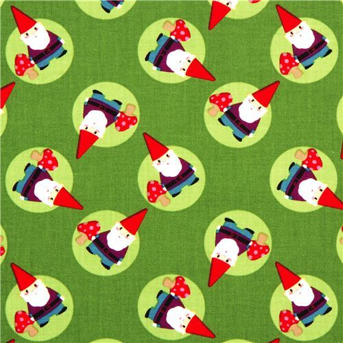 green designer fabric with tossed gnomes and mushrooms