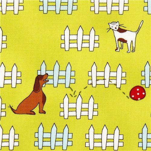 green designer fabric with dog cat fence ball