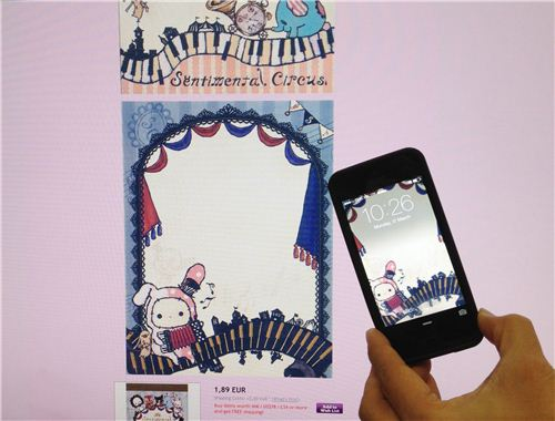 We used this picture of a Sentimental Circus memo pad page as a phone wallpaper