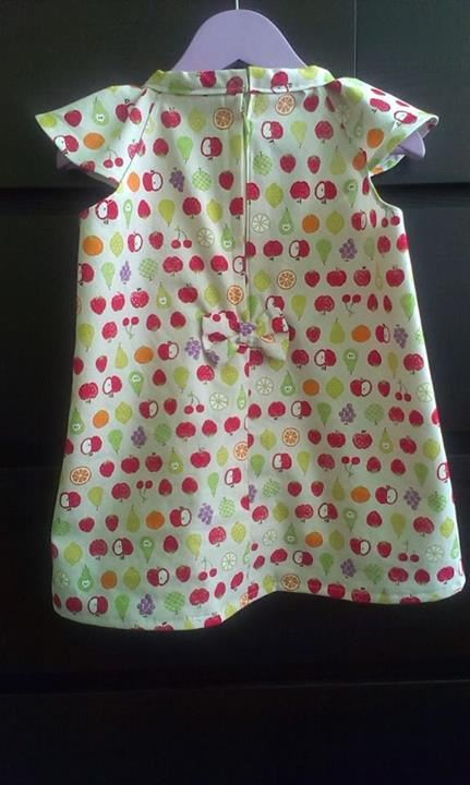 Joanna Lef from Switzerland made this kawaii girl's dress with our Cosmo apple fabric