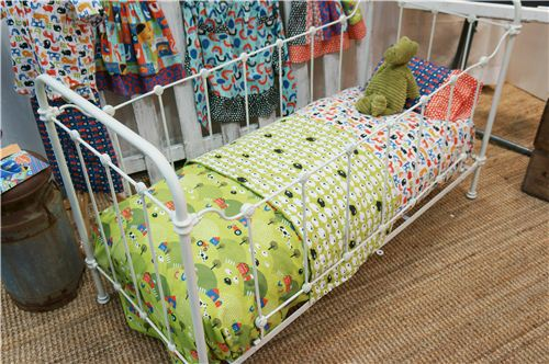 The monaluna fabrics used to decorate this children's bed look awesome