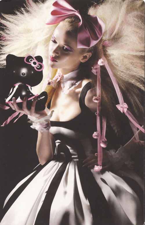 MAC model with black Hello Kitty